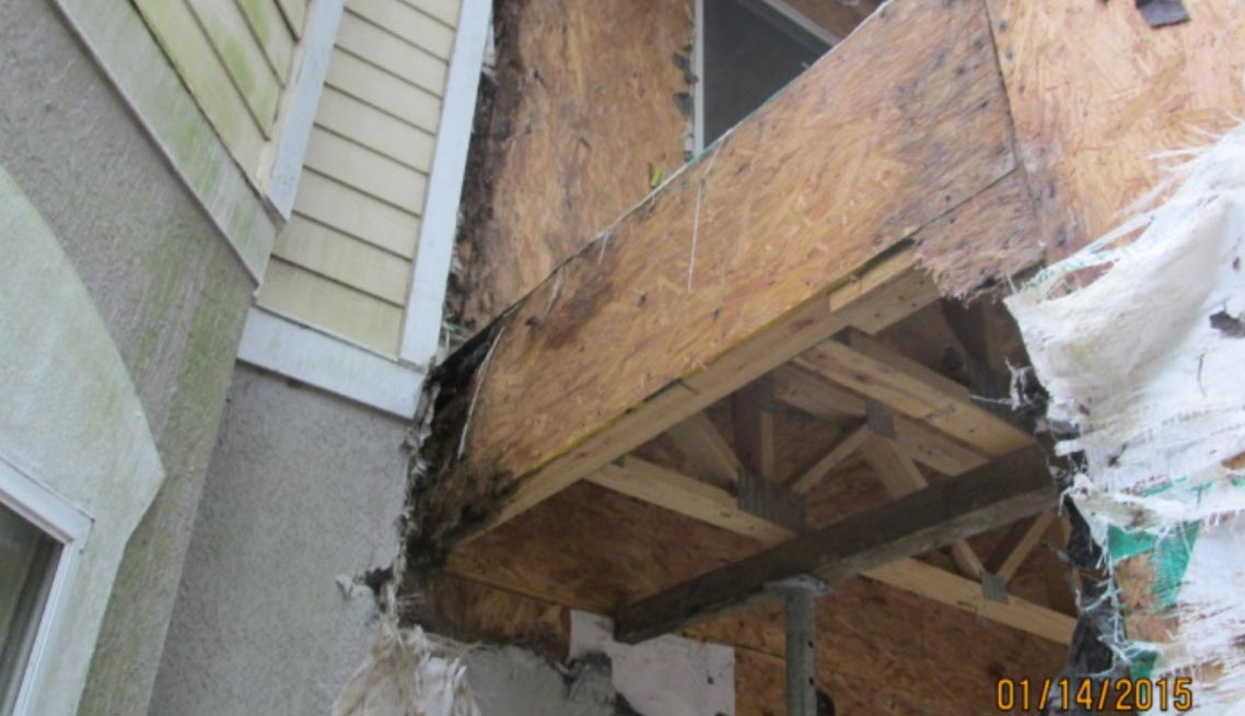 Water Damage at Balcony Framing