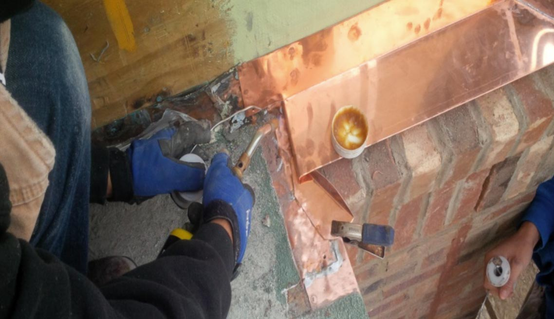 Copper Brick Flashing at Deck with Kick Out